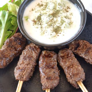 A plate of kofta in skewers and dip