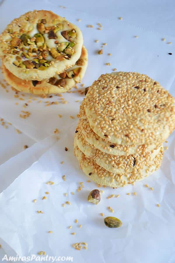 two stacks of barazek cookies one with the sesame side top and the other with the pistachio side top
