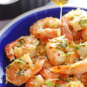 A close up of baked shrimp on a plate