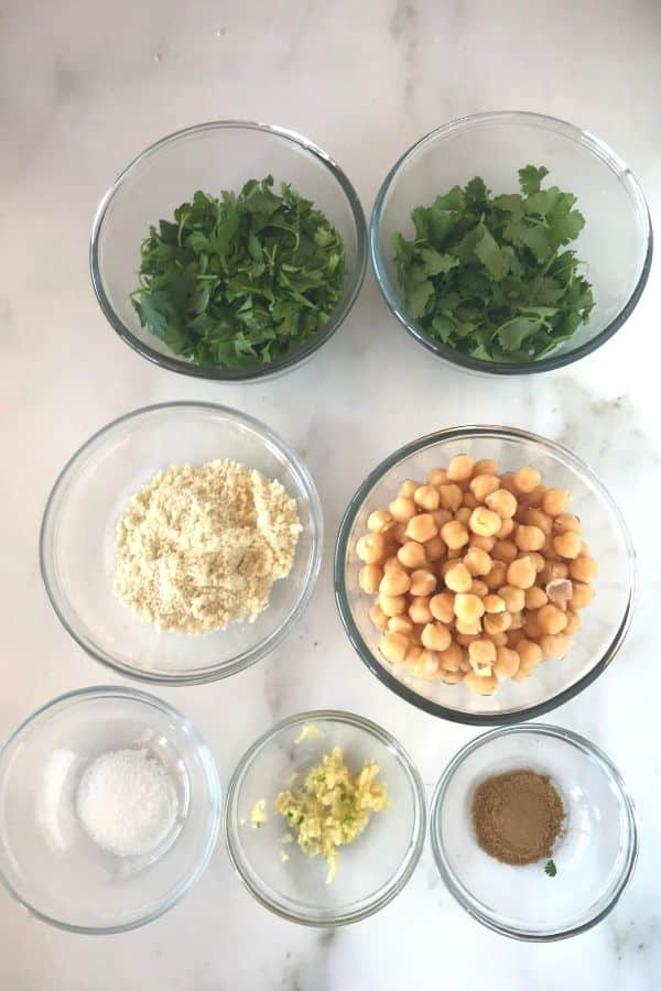A photo showing ingredients for making falafel with chickpeas