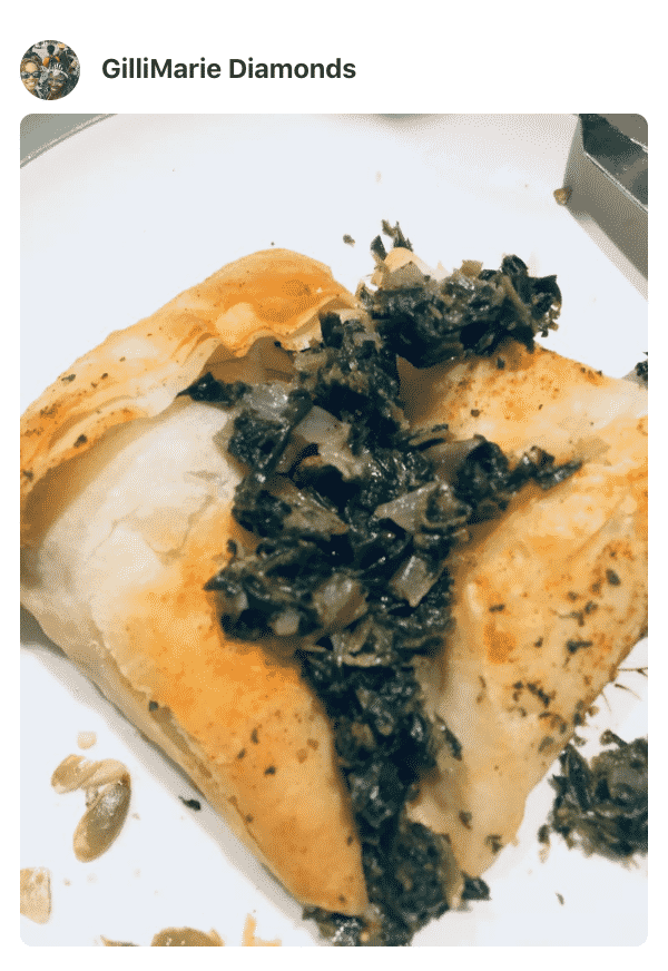A plate of food with Spanakopita and spinach