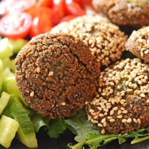 A close up of food Falafel on a plate with vegetables