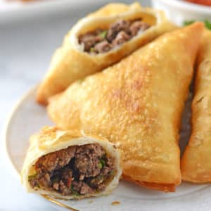 A closeup Samosa cut and showing ground beef