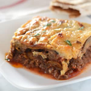 A close up of food on a plate, with Moussaka
