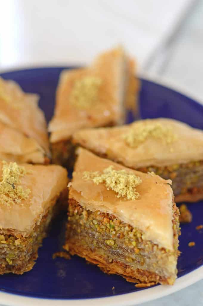 A close up of Baklava pieces cut in a plate