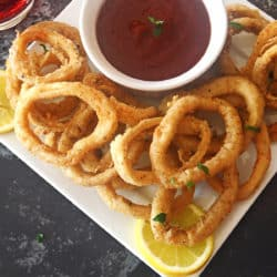A close up of fried onions on a table