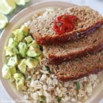 turkey meatloaf slices on a plate with cooked barley and diced avocado