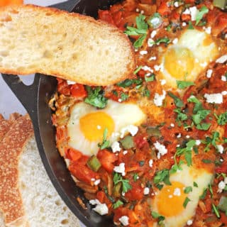 A close up of a part of Shakshouka in a Pan