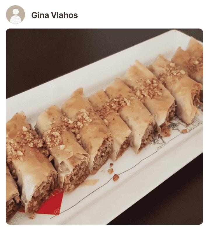 Baklava rolls on a white plate, made by a fan