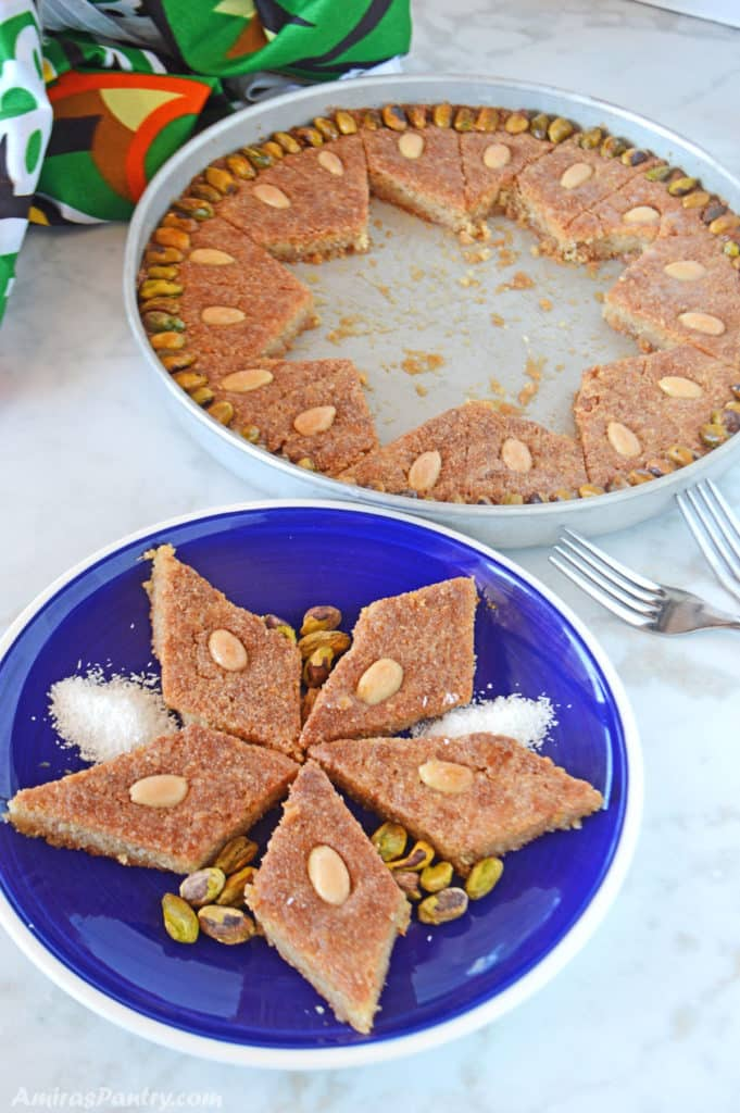 pieces of semolina cake on a blue plate with the whole baking dish on the back