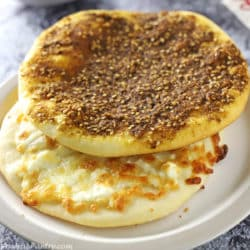 Za'atar and cheese manakeesh stacked on a light brown plate
