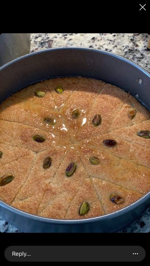 A pan filled with Basbousa and pistachios