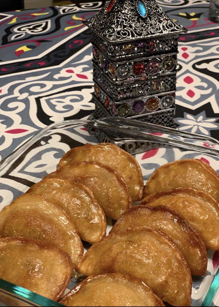 A close up of food, with Qatayef made by a fan