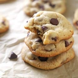 A stack of cookies with a bite taken from the top one.