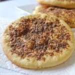 Manakeesh with za'atar made with the dough and placed on a white kitchen towl