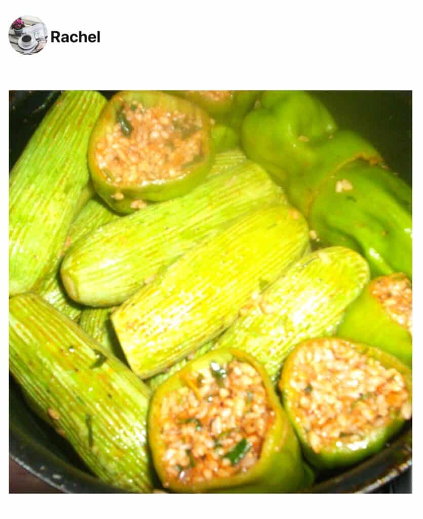 A close up of stuffed vegetables in a pan, made by a fan