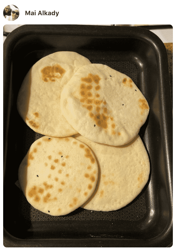 A photo showing Pita bread in a pan made by a fan