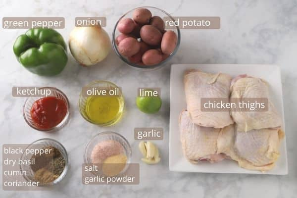 Chicken thighs recipe ingredients placed on a white table.