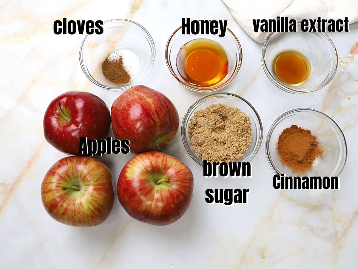 A picture of apple butter ingredients on a mrable table.