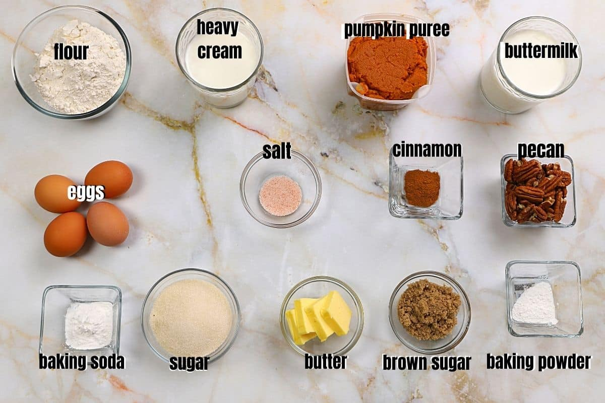 Ingredients for pumpkin pecan cake on a tabletop.
