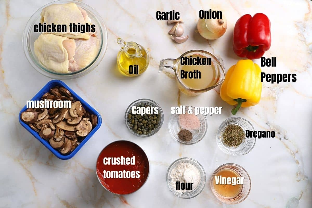 Chicken cacciatore ingredients on a marble table.