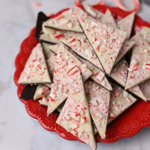 peppermint bark triangles on a red plate.