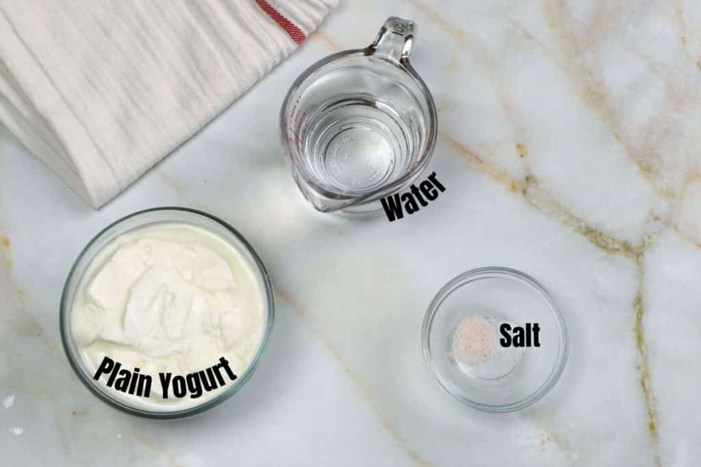 Ayran ingredients on a white marble table.