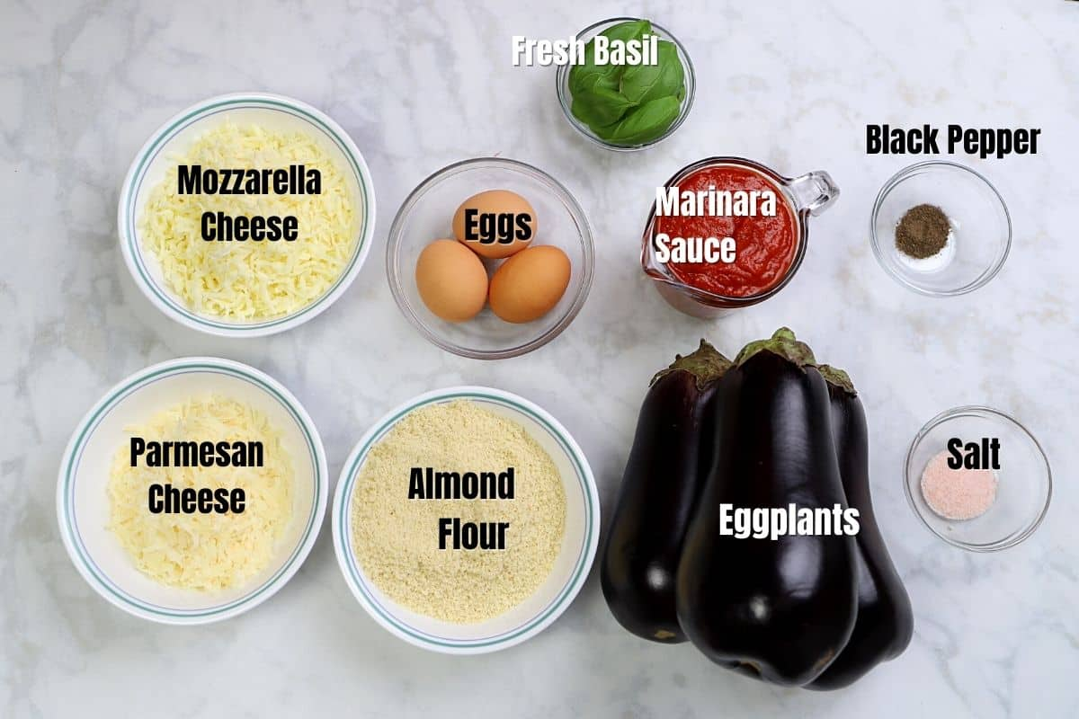 Low carb eggplant parmesan ingredients place on a marble surface.