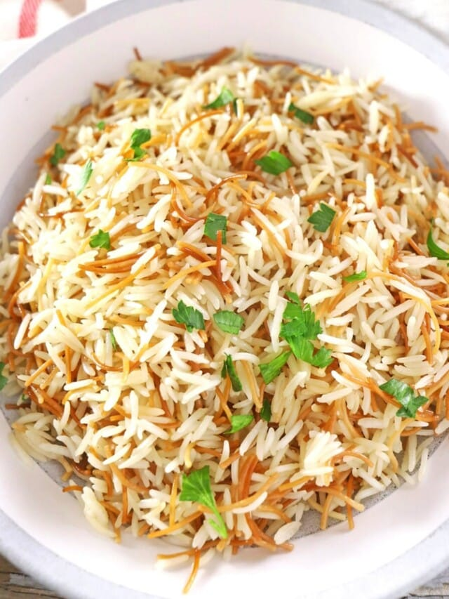 A big bowl of Lebanese rice garnished with parsley.