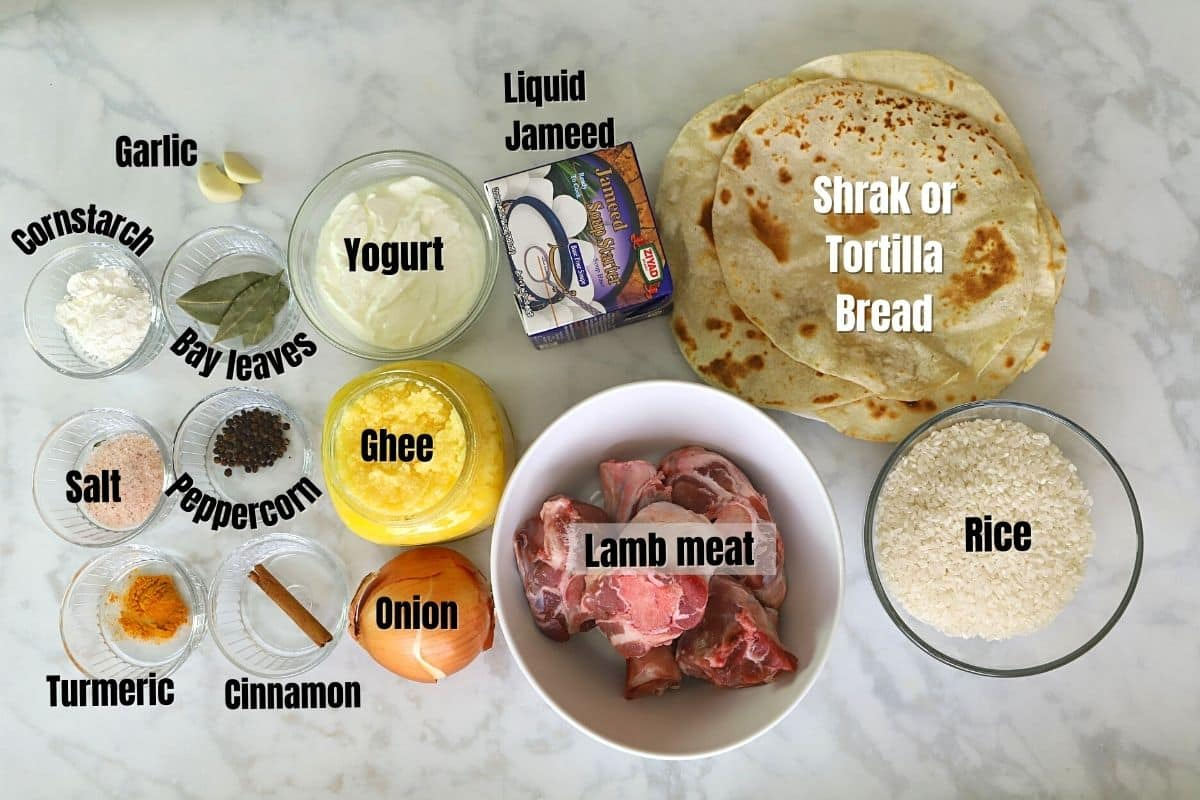 Mansaf ingredients on a white table.