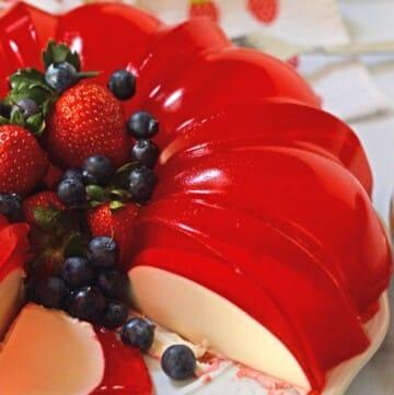 A close up photo of cream jello Cake on a plate