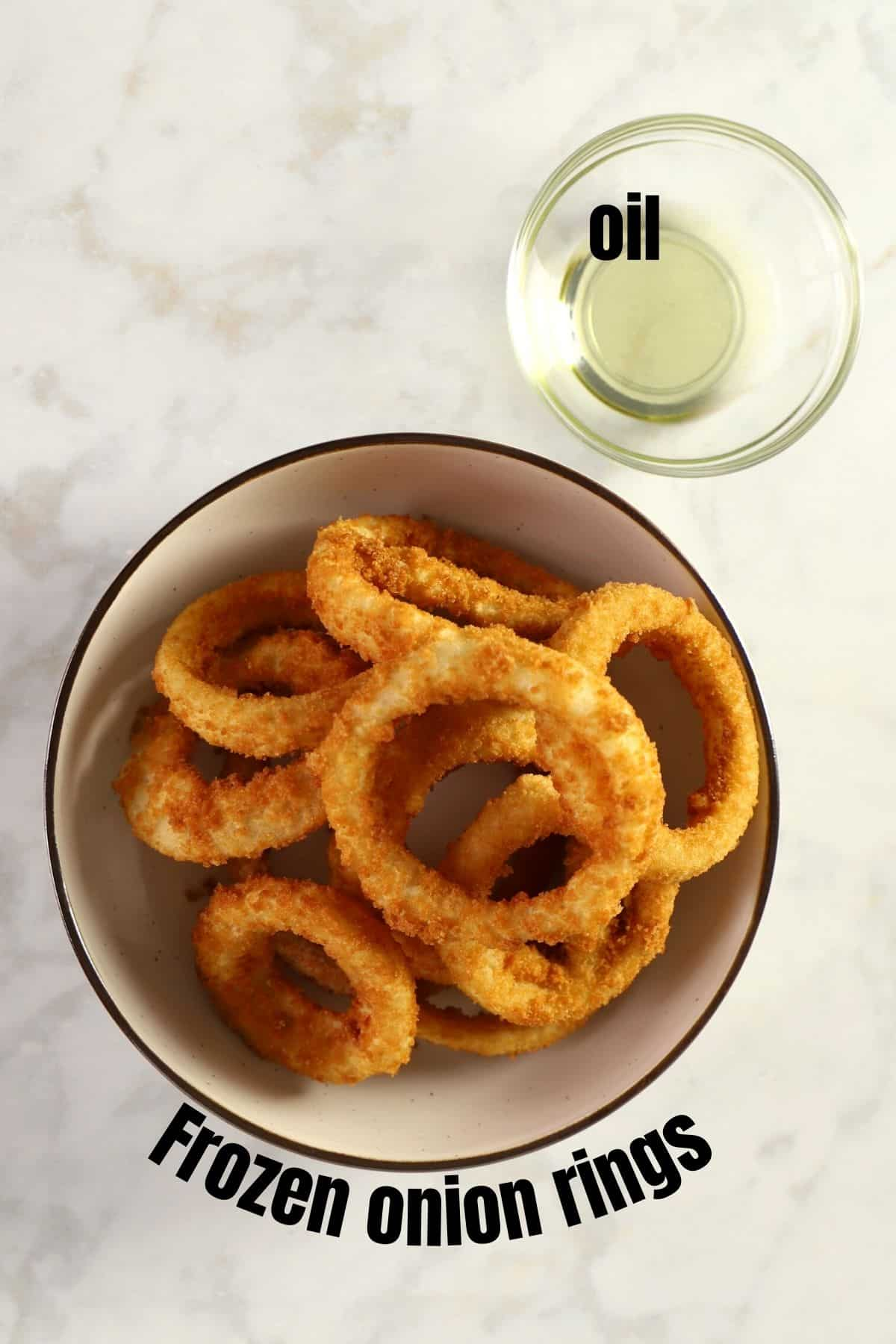 Ingredients for frozen onion rings placed on a white surface.