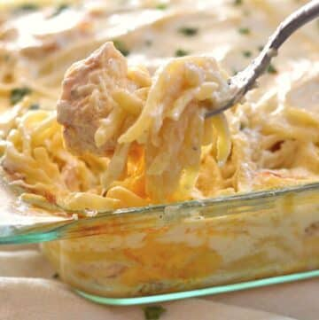 A fork taking some of the chicken tetrazzini out of the casserole.